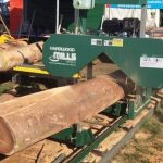 saw logs into lumber using portable sawmill from Hardwood Mills team